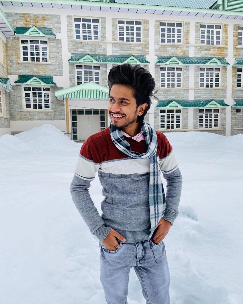 ansh pandit tiktok star in snow during holidays.