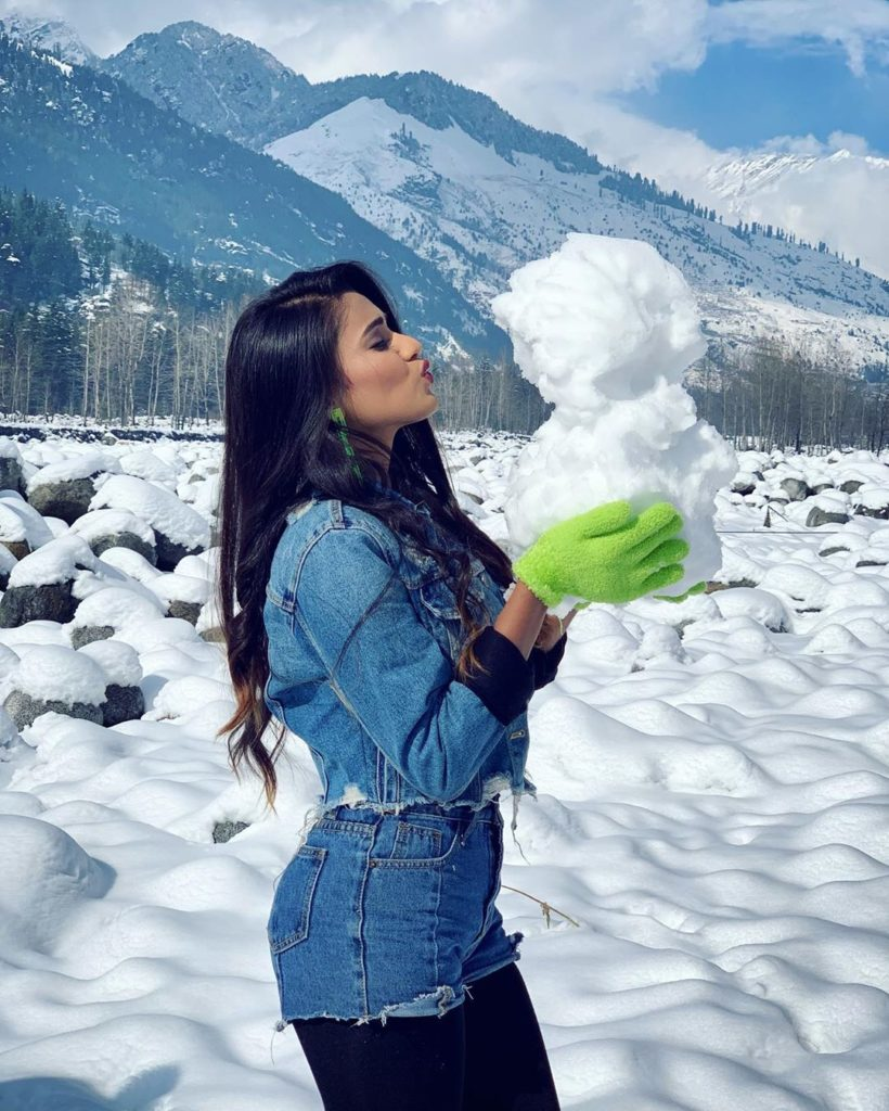 Garima playing with snow